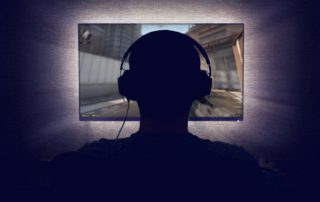 Gamer in front of a monitor