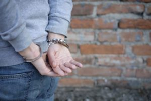 man arrested in handcuffs