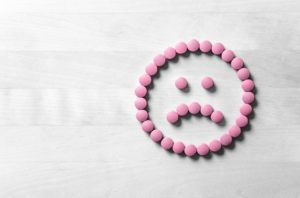 sad smiley face made from pills